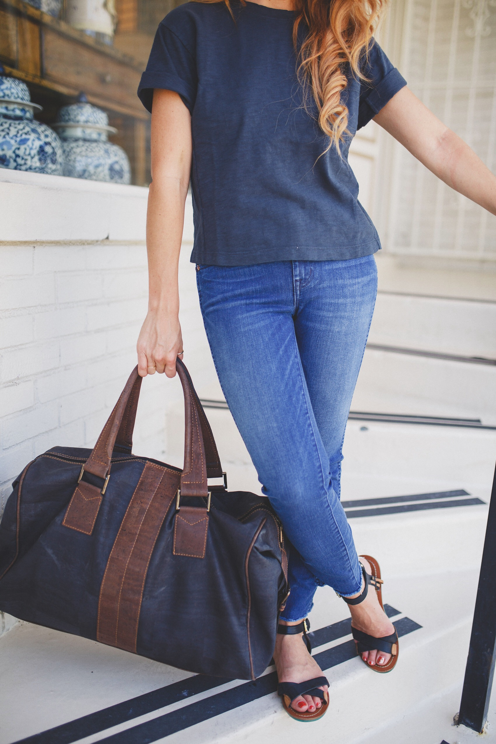 eve duffle bag, vegan leather travel bag and madewell denim
