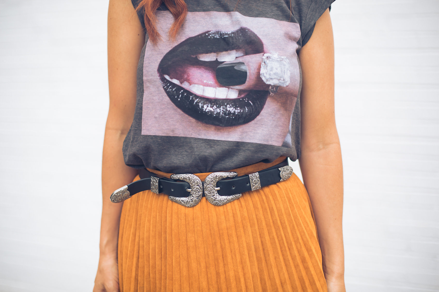 faux suede skirt with double buckle belt and graphic tee